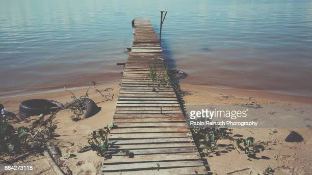 wooden walkway. - posadas stock pictures, royalty-free photos & images