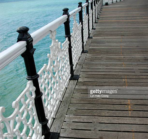 wooden walkway with wrought iron railings - lyn holly coorg imagens e fotografias de stock