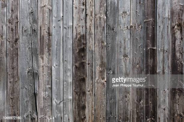 wooden wall background - old house facade - staccionata foto e immagini stock