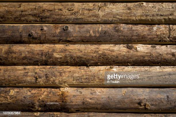 wooden wall from logs as a background texture - log stock pictures, royalty-free photos & images