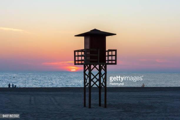 Wooden watchtower on the beach in Cadiz, Spain