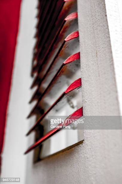 wooden white window pane with red flips. - caroline pang stock pictures, royalty-free photos & images