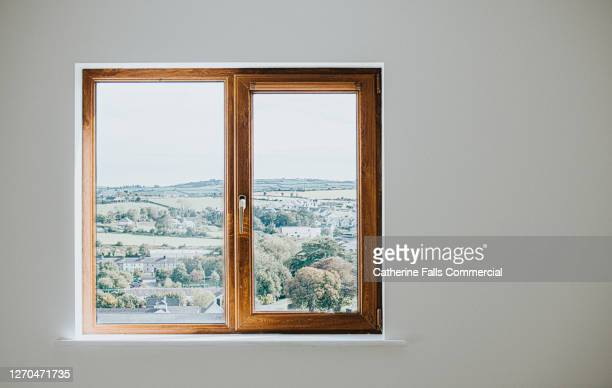 wooden window frame set in a plain white wall - inside of stock pictures, royalty-free photos & images