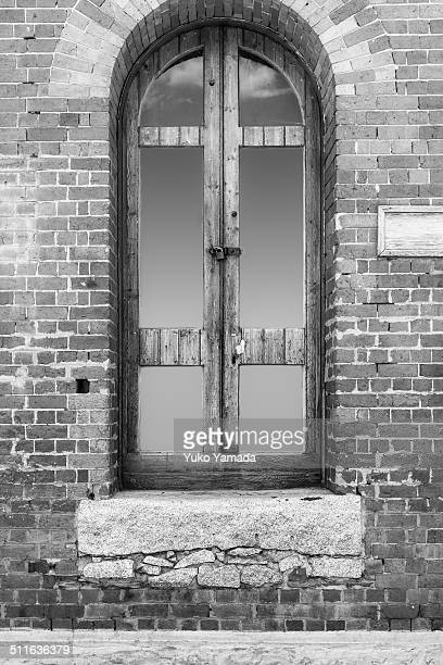Wooden window of a brick building