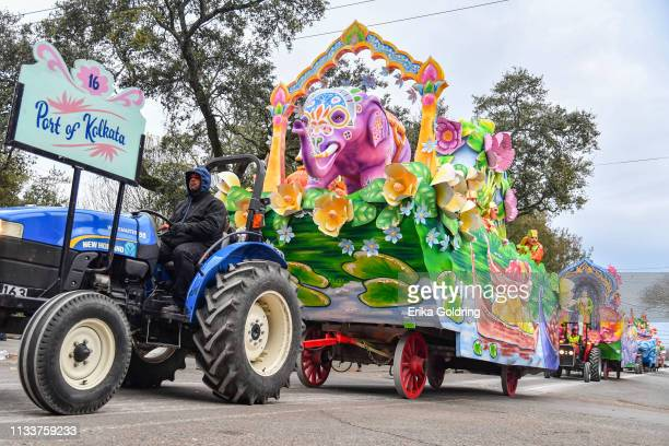 Wooden-wheeled wagons carry The Krewe of Proteus as they roll along the traditional Uptown parade route with the theme 'Travel and Treasures of the...