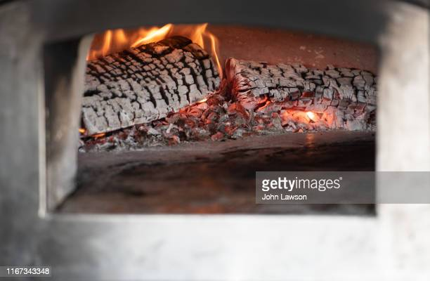 wood-fired pizza oven - firewood stock pictures, royalty-free photos & images