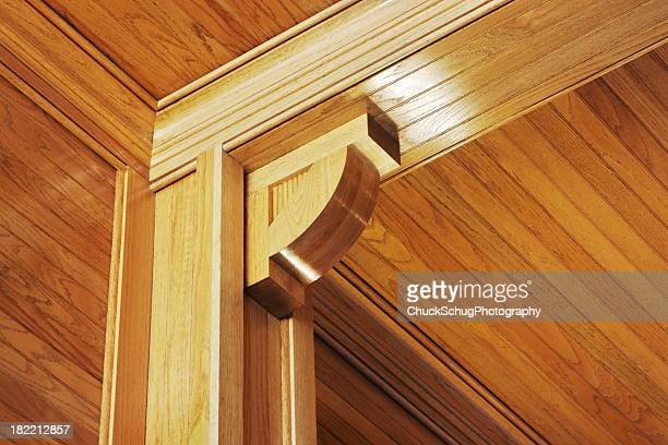 woodgrain paneling pillar beam moulding - flying buttress stock photos and pictures