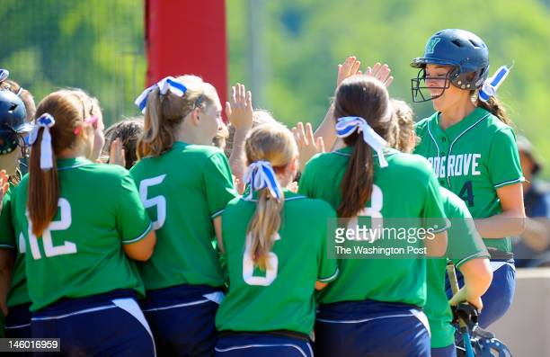 Woodgrove's Ashley Cole right is greeted at home plate after hitting a1st inning home run to give her team a 1 0 lead as Woodgrove went on to defeat...