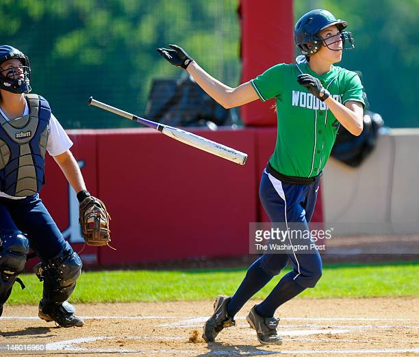 Woodgrove's Ashley Cole right watches her 1st inning home run go over the right field fence to give her team a 1 0 lead as Woodgrove went on to...