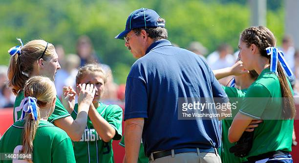 Woodgrove's head coach Joe Spicer center has a word with his team between innings as Woodgrove defeats Abingdon 3 1 in Virginia State AA girls...