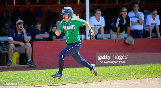 Woodgrove's Katie Sholl heads home for her team's 3rd run on a Moler 6th inning 2 run RBI as Woodgrove defeats Abingdon 3 1 in Virginia State AA...