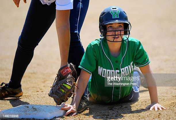 Woodgrove's Mackenzie Moler dives back to 1st base after hiting a 6th inning 2 run RBI as Woodgrove defeats Abingdon 3 1 in Virginia State AA girls...