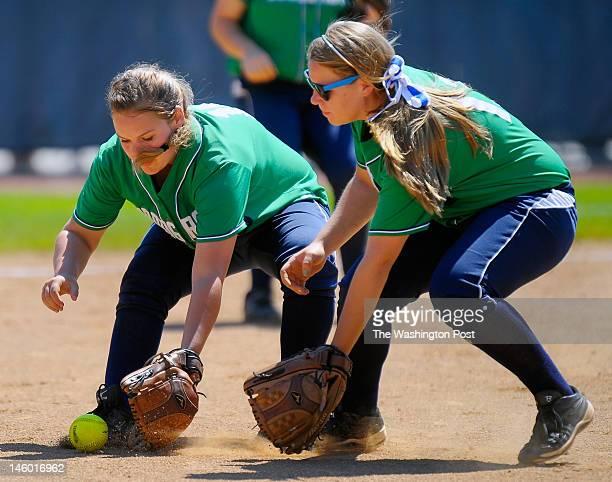 Woodgrove's Pitcher Allie Reid left fields a grounder with infielder Rachel Harris right moving in as Woodgrove defeats Abingdon 3 1 in Virginia...