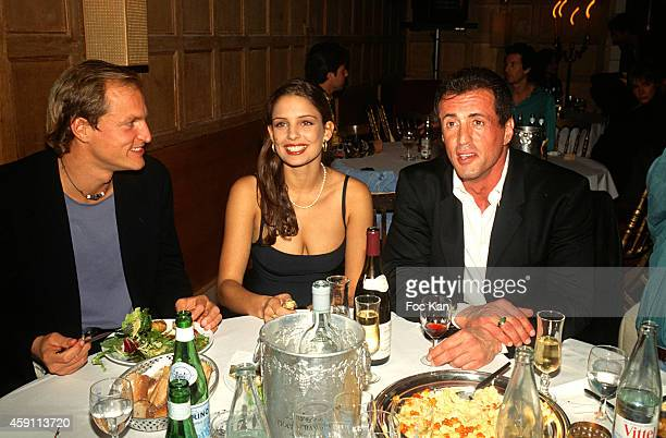 Woodie Harrelson a guest and Sylvester Stallone attend a fashion week Party at Les Bains Douches in the 1990s in Paris France