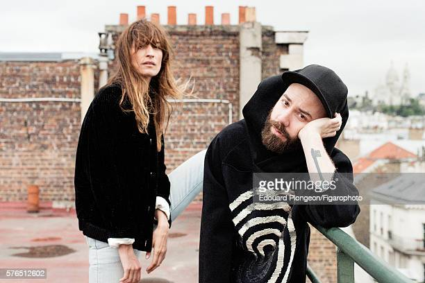 Woodkid and Caroline de Maigret are photographed for Madame Figaro on May 9 2016 in Paris France Woodkid Sweater hat Caroline de Maigret Jacket jeans...