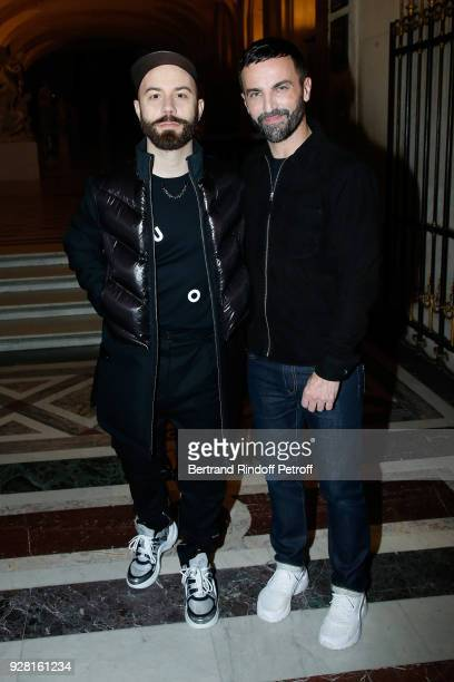 Woodkid and Stylist Nicolas Ghesquiere pose after the Louis Vuitton show as part of the Paris Fashion Week Womenswear Fall/Winter 2018/2019 on March...