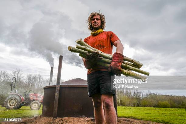Woodland Manager Reece Jacobs makes charcoal the traditional way by firing small batches of ash trees in a kiln on the Carsawsan estate on April 09,...