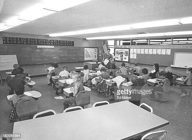 OCT 8 1963 Woodlin Mrs Ethel Tuttle leads a first grade Class