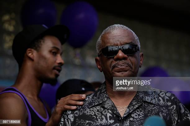 Woodrow Aldridge right attends a prayer vigil for his daughter Nykea Aldridge outside Willie Mae Morris Empowerment Center on August 28 2016 in...