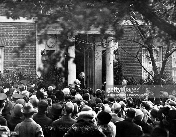 Woodrow Wilson standing in doorway of his home on S Street in Washington speaking to several thousand wellwishers who are congratulating him on...