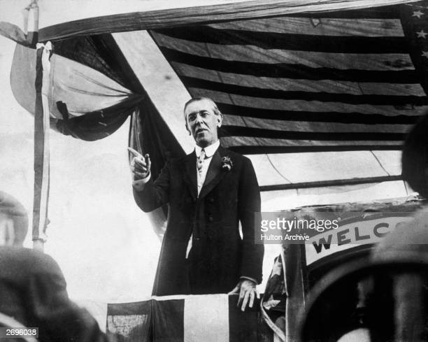 Woodrow Wilson the 28th president of the United States points with his finger while making a speech from a platform on his campaign trail Virginia