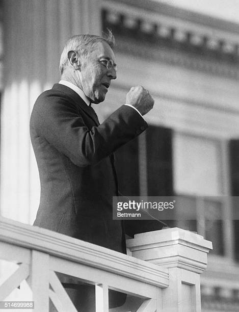 Woodrow Wilson using a clenched fist to make a point