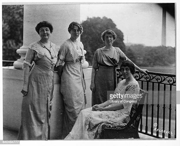 Woodrow Wilson's first wife Ellen Louise Axson stands at the White House with her three daughters Eleanor Margaret and Jessie