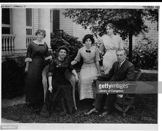 Woodrow Wison sits with his wife Ellen Louise Axson and his three daughters Margaret Jessie and Eleanor