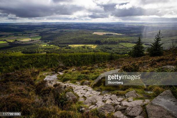 Woods and fields stand in this view from Bennachie Visitor Centre near Inverurie UK on Monday Sept 30 2019 Scotland has taken in more refugees per...