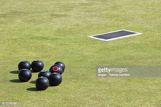 Woods and mat, lawn bowls