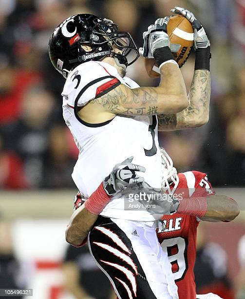 Woods of the Cincinnati Bearcats catches a touchdown pass during the Big East Conference game against the Louisville Cardinals at Papa John's...