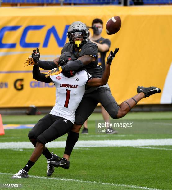 Woods of the Pittsburgh Panthers is called for pass interference as he defends against Tutu Atwell of the Louisville Cardinals in the second half...
