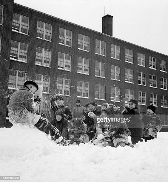 Woodside, NY- ORIGINAL CAPTION READS: Although the board of education ordered schools to remain closed here March 4th because of a 14-ince layer of...