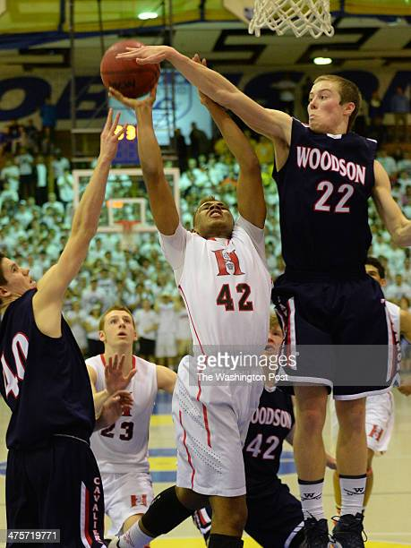 T Woodson F Jimmy McLaughlin blocks a shot by Herndon F Brandon Alston at the end of regulation during the Virginia 6A North region semifinals on...
