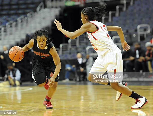 Woodson's Breonn Hughey runs the ball down court towards St John's Lindsay Allen during the Abe Pollin City Title game at the Verizon Center on...