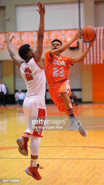 Woodson's Kavon Montgomery left cannot stop Coolidge's BJ Hill driving for a 3rd quarter basket during HD Woodson defeat of Coolidge 42 35 in the...