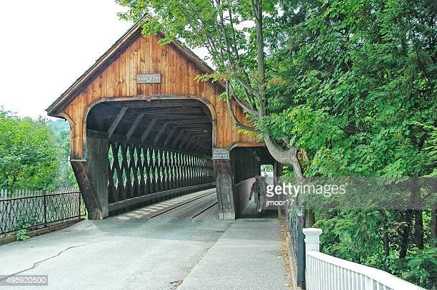 woodstock vermont covered bridged with visitors - covered bridge stock pictures, royalty-free photos & images