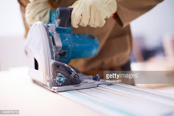 woodwork, carpenter sawing wood - stichsäge stock-fotos und bilder