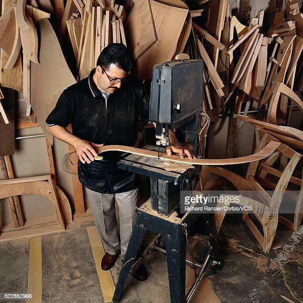 Woodworker in Workshop Using Jigsaw