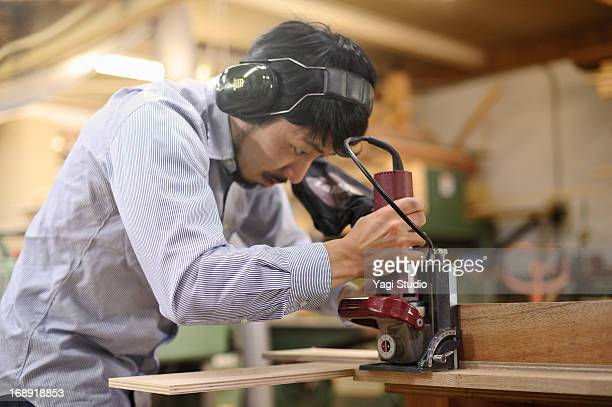 Woodworker making furniture in workshop