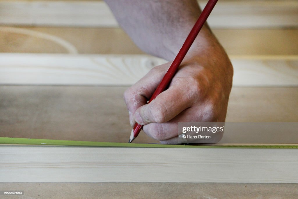 Woodworking lefthanded : Stock Photo