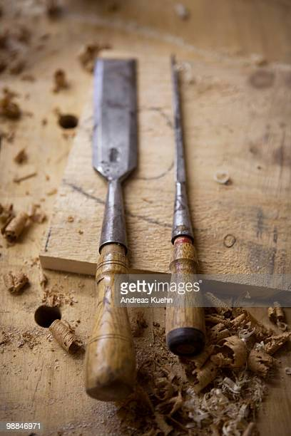 Woodworking tools on workbench, close up.