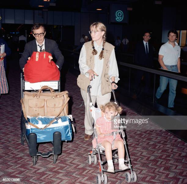 Woody Allen and his partner actress Mia Farrow with some of their children at London Heathrow Airport 8th August 1988