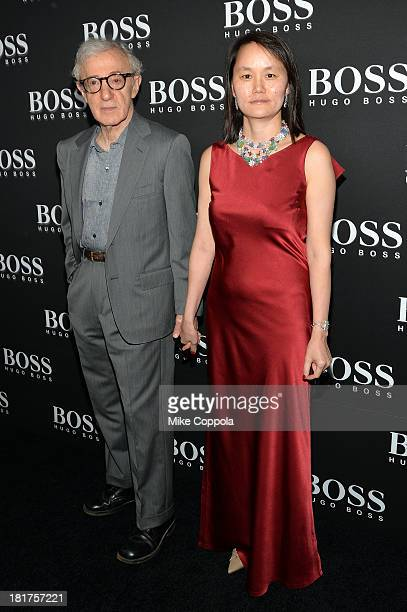 """Woody Allen and Soon Yi Previn attend HUGO BOSS celebrates Columbus Circle BOSS flagship opening featuring premiere of """"Anthropocene,"""" by Marco..."""
