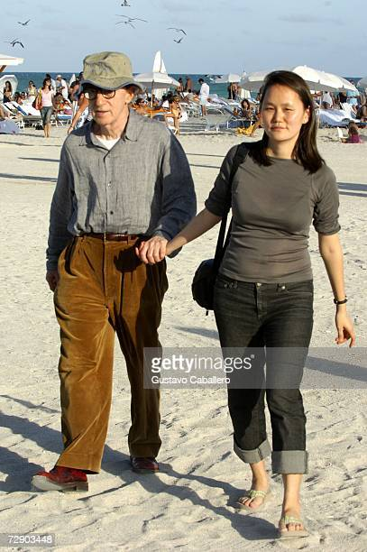 Woody Allen and wife Soon Yi Previn walk on the beach on December 29, 2006 in Miami Beach , Florida.