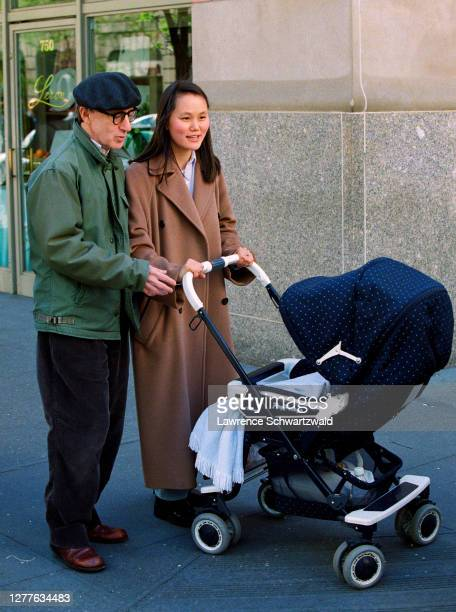 Woody Allen and wife, Soon-Yi Previn out for a stroll for the first time with newly adopted daughter, Bechet Dumaine Allen on April 24, 1999.