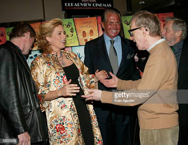 Woody Allen greets pregnant Tea Leoni with Treat Williams and George Hamilton at the Hollywood Ending film premiere at Chelsea West Cinema in New...