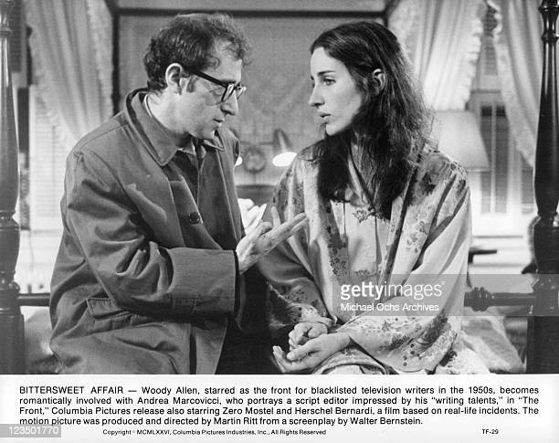 Woody Allen sits in a bedroom talking with Andrea Marcovicci in a scene from the film 'The Front' 1976