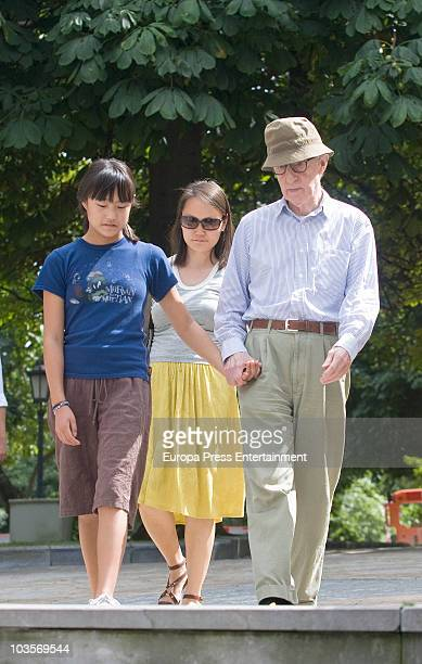 Woody Allen SoonYi Previn and Manzie Tio go for a wall on August 24 2010 in Oviedo Spain