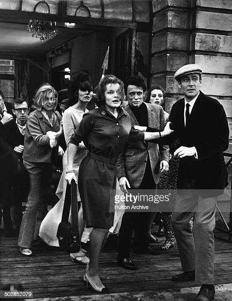 Woody Allen Ursula Andress Paula Prentiss Romy Schneider and Peter O'Toole run out of the building in a scene of the movie What's New Pussycat circa...